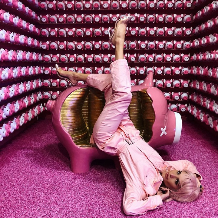 Ava Marie Capra laying upside down a couch with a look like 'Ashley O' from a 'Black Mirror' episode.