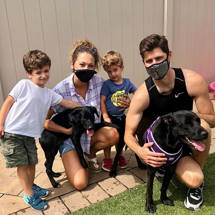 Ginger Zee (second from left) and Ben Aaron (far right) with their two sons and two dogs.